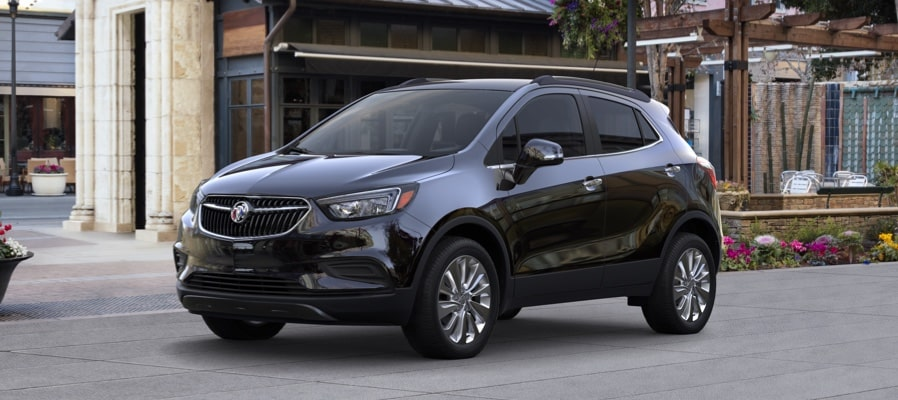 2019 Buick Encore Small Luxury SUV:  Exterior front quarter view. Proud partner of the NCAA.