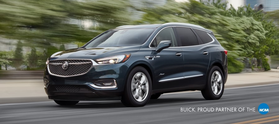 2019 Buick SUV Vehicle Lineup: Encore, Envision, and Enclave with a city background. Proud partner of the NCAA.