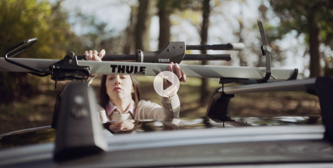 Video of a person using the racks on top of the Buick TourX luxury wagon for storage.
