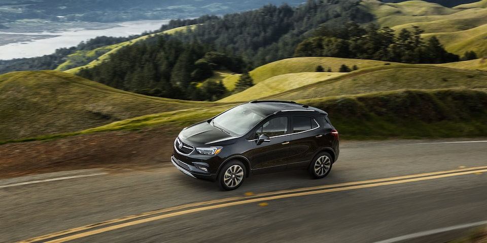 Buick Encore SUV driving through the countryside
