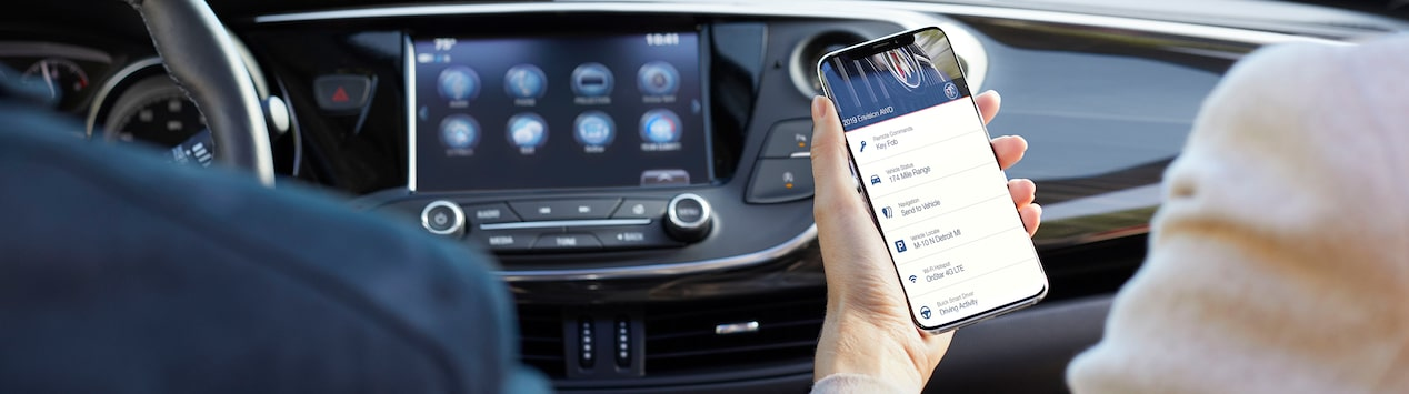 Image of someone using their smartphone in a Buick vehicle.