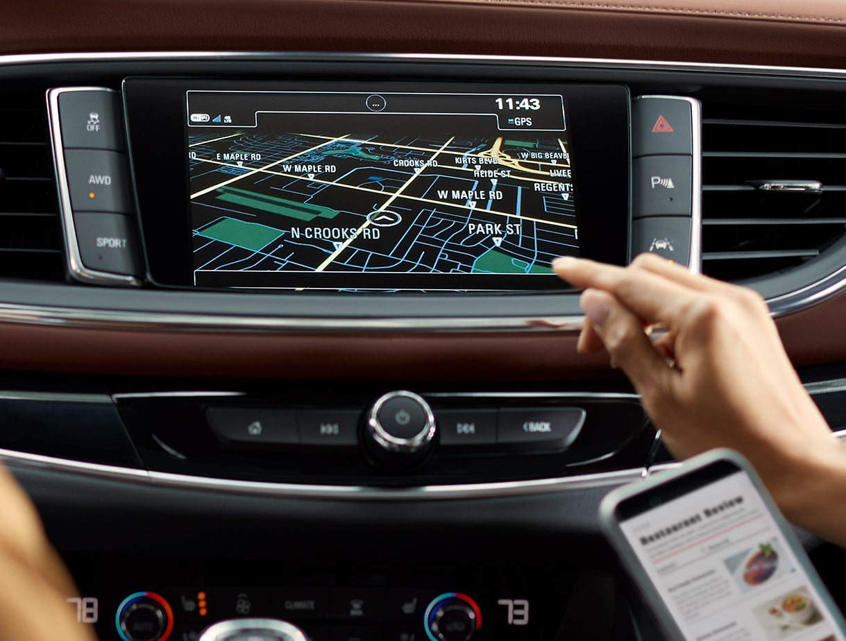 Closeup image of the color touch display in a Buick vehicle using the smart radio  features.
