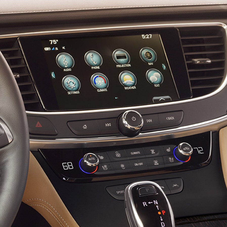 Image of a woman using her  smartphone to access the myBuick app and control key features of her Buick vehicle.