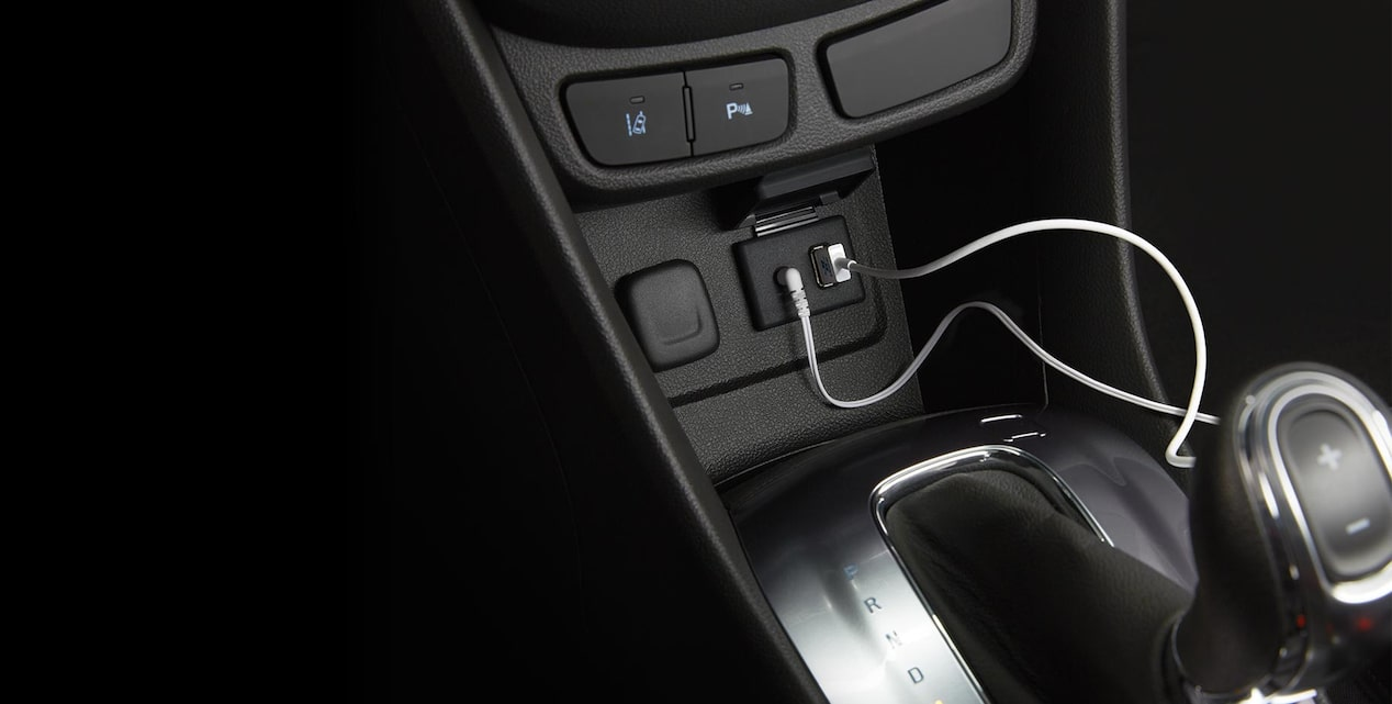 Closeup image of the available USB power ports available in the center console of a Buick vehicle.