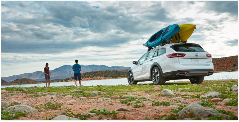 Image of the 2018  Buick Regal TourX luxury wagon with two kayaks mounted on top.