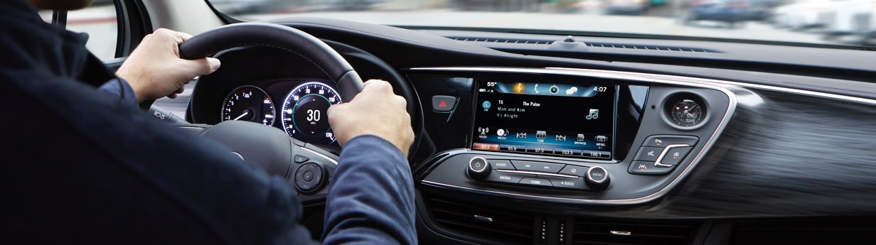 Image of a person using the SiriusXM radio function on the Buick Infotainment system.