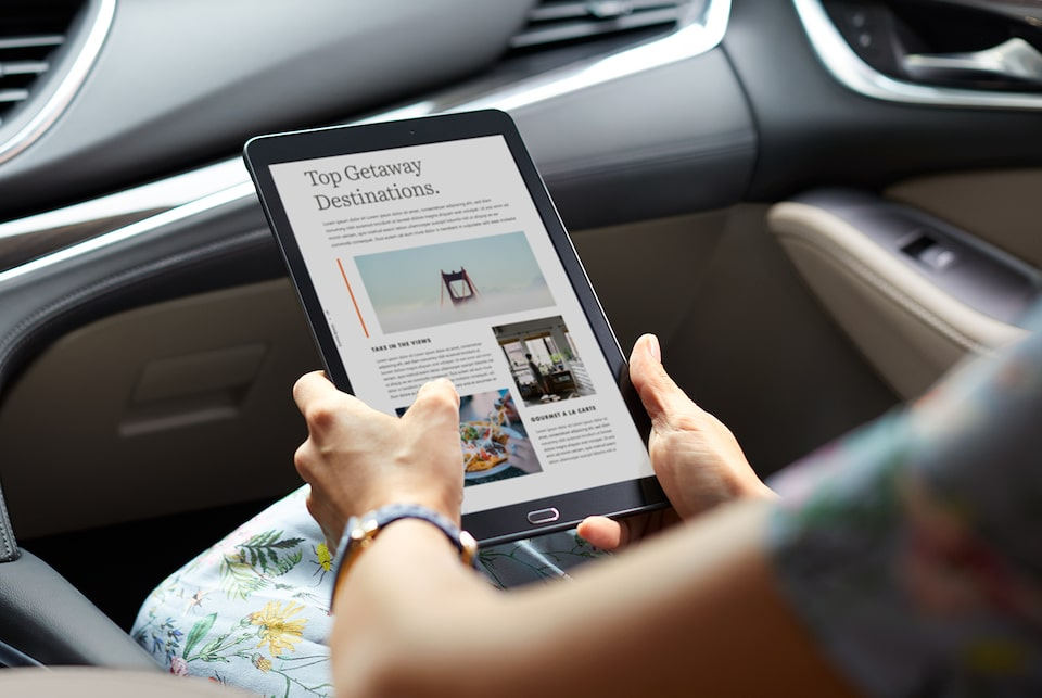 2020 Buick with tablet viewing top getaway destinations