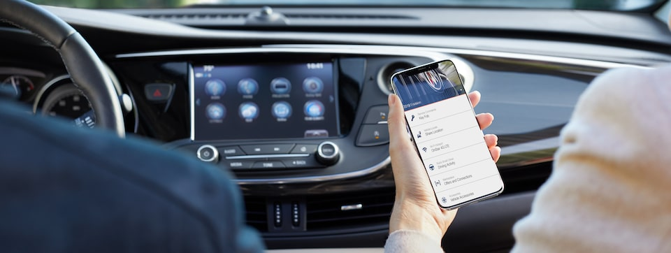 Image of someone using a smartphone to access the myBuick App