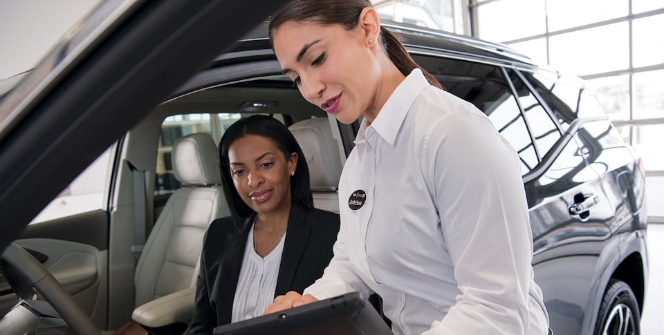 Woman in Buick getting helped by Certified Service Expert