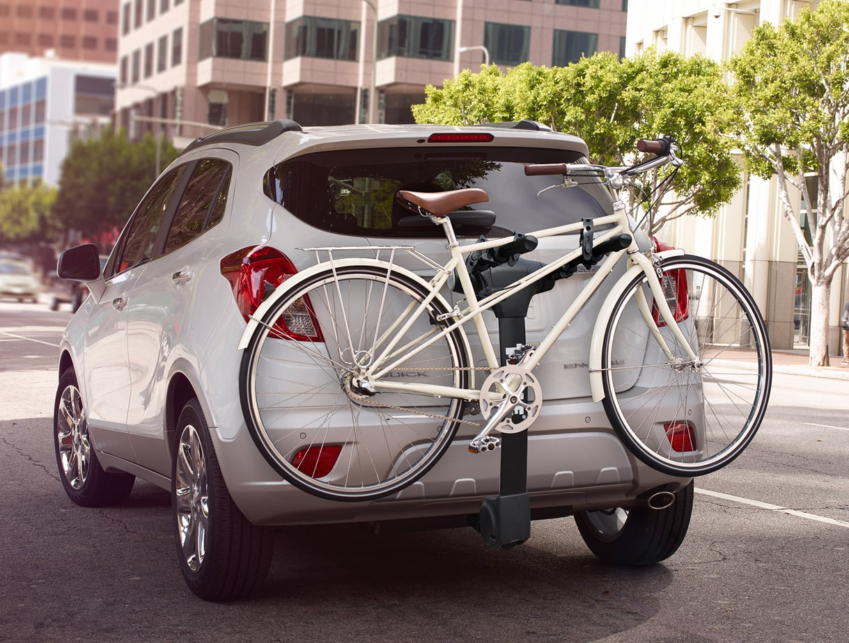 Image of a bike mounted on top of a Buick vehicle.