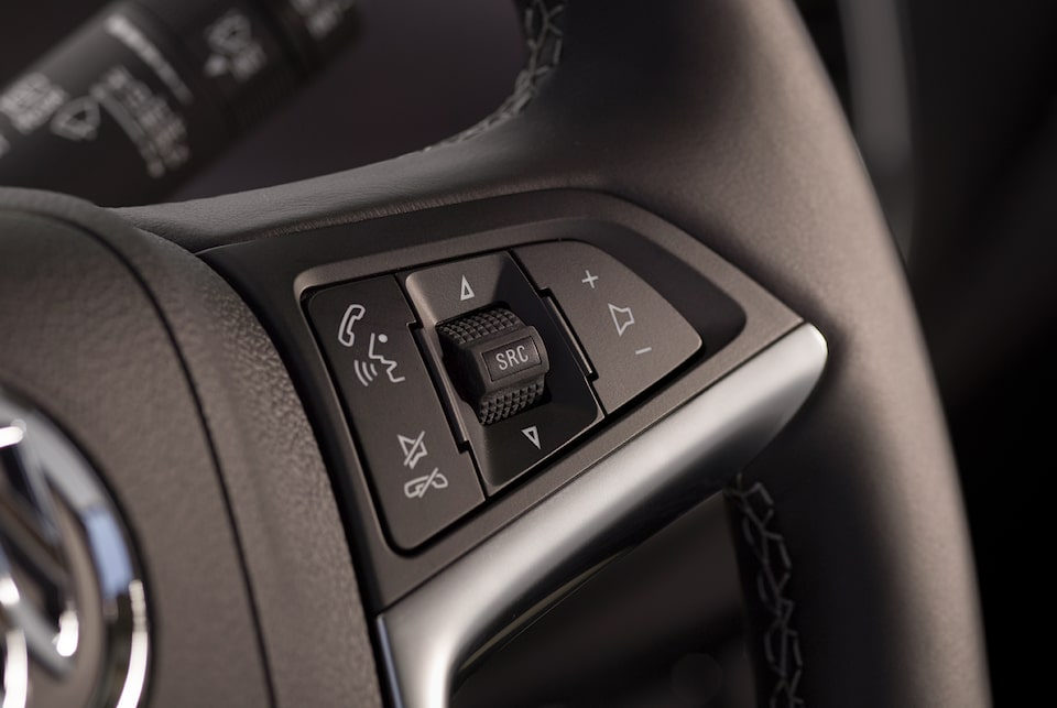 Image of bluetooth access control on the steering wheel of a Buick vehicle.