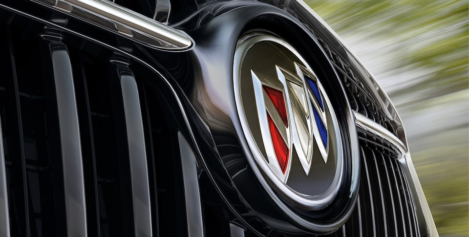 Image of Buick logo on the grille of a vehicle.