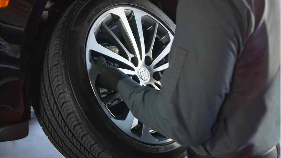 Buick Protection Service Expert Checking Tire