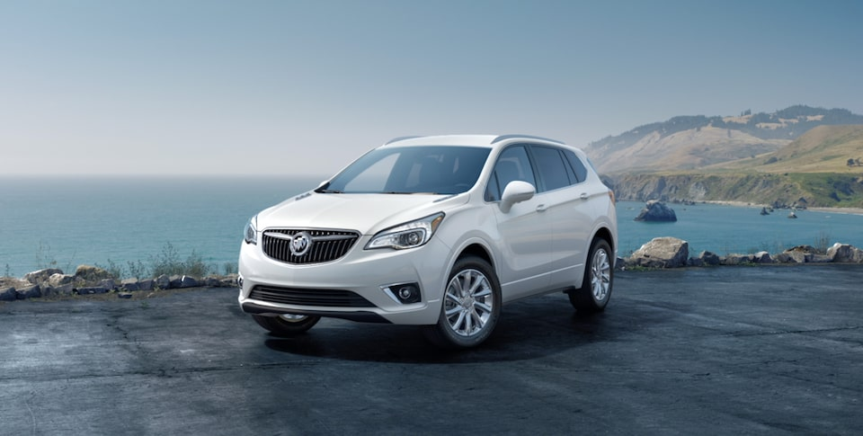 2019 Buick Envision Compact Luxury SUV: parked in a driveway corner shot. Proud partner of the NCAA.