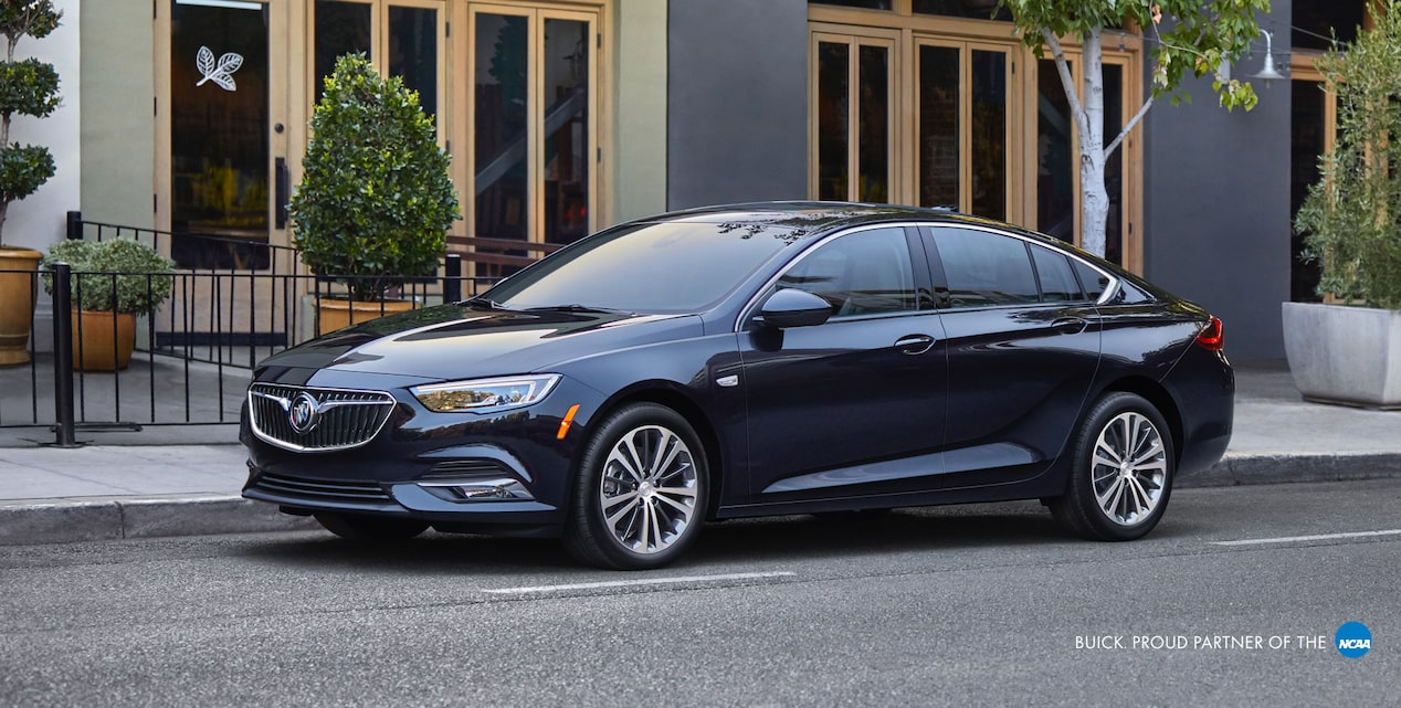 2018 Buick Regal Sportback Luxury Sedan: Parallel parked in front of storefronts. Proud partner of the NCAA.