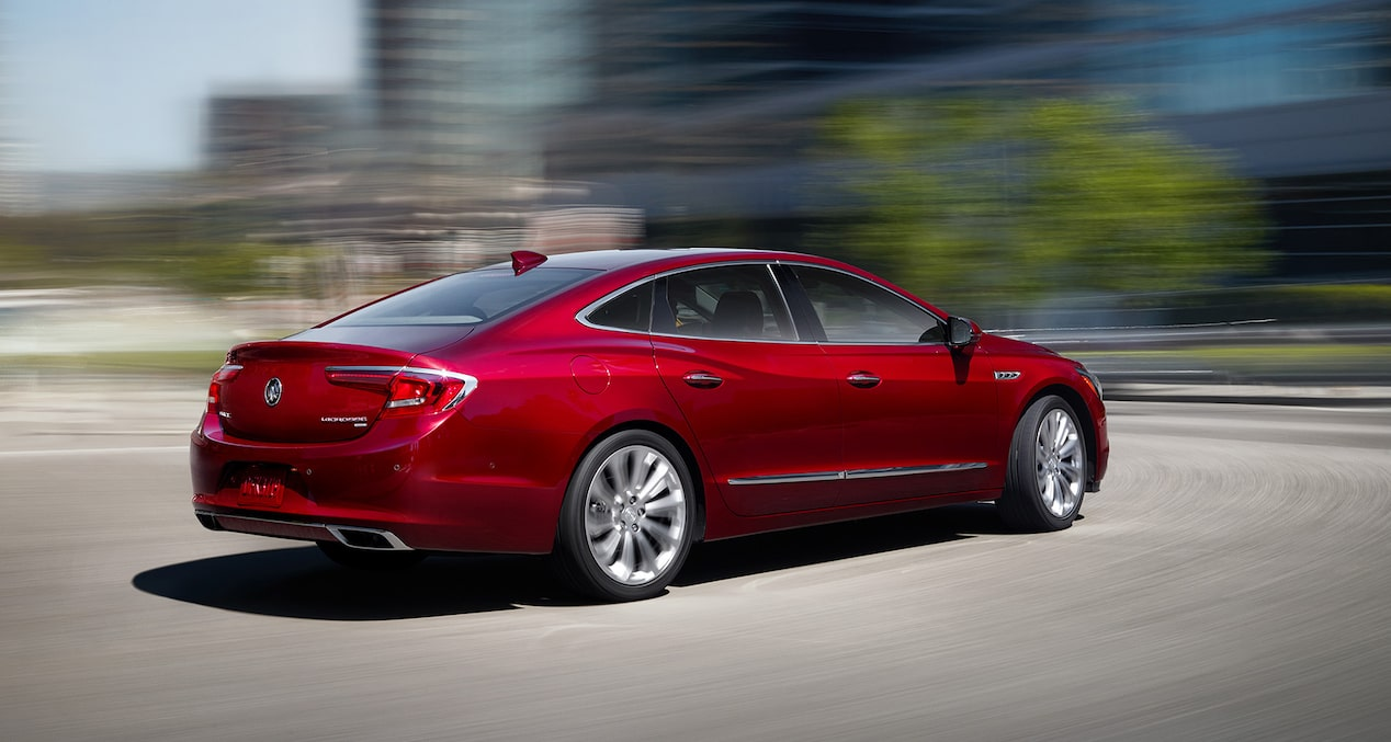 Image of the 2017 Buick LaCrosse full-size luxury sedan in motion in a parking lot.