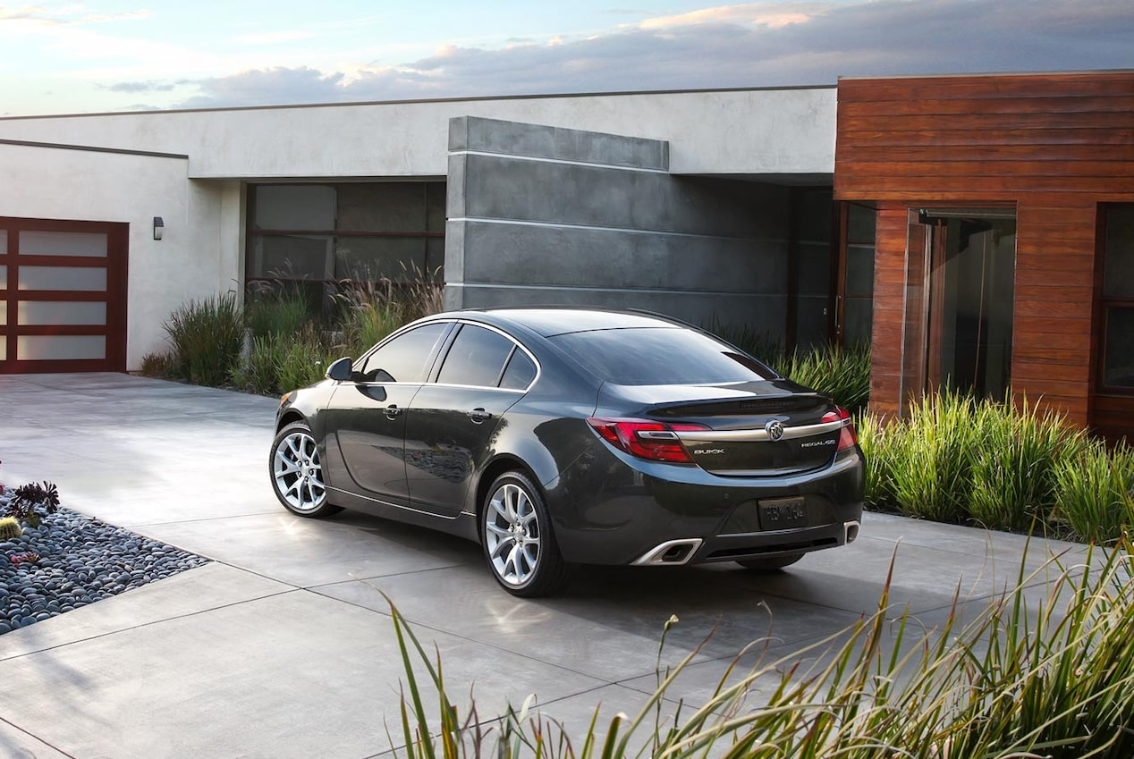 Image of the 2017 Buick Regal mid-size luxury sedan parked in front of a modern home.