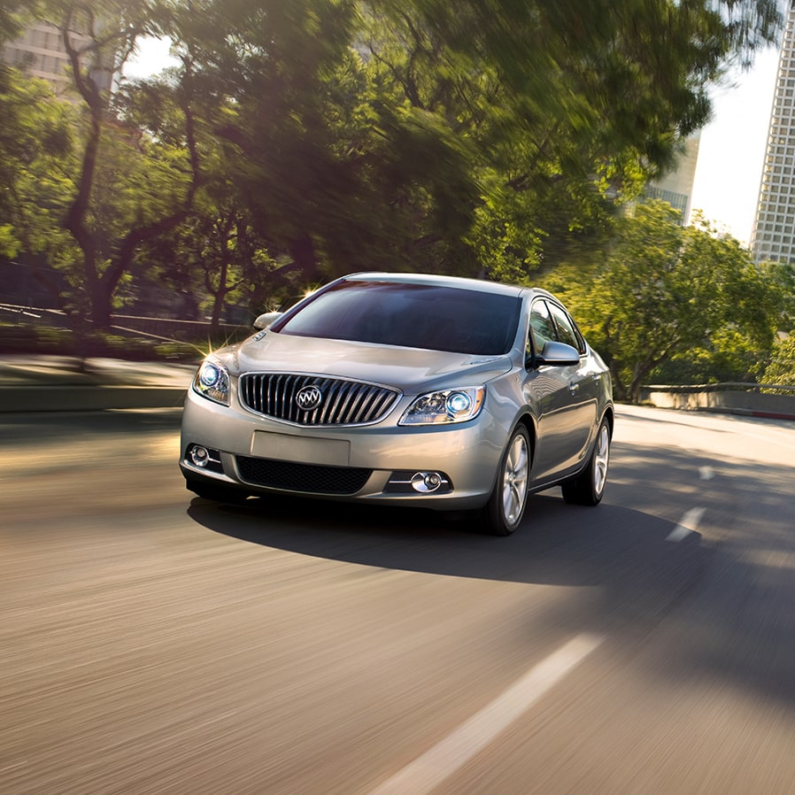 Image of the 2017 Buick Verano small luxury sedan in motion on the street.