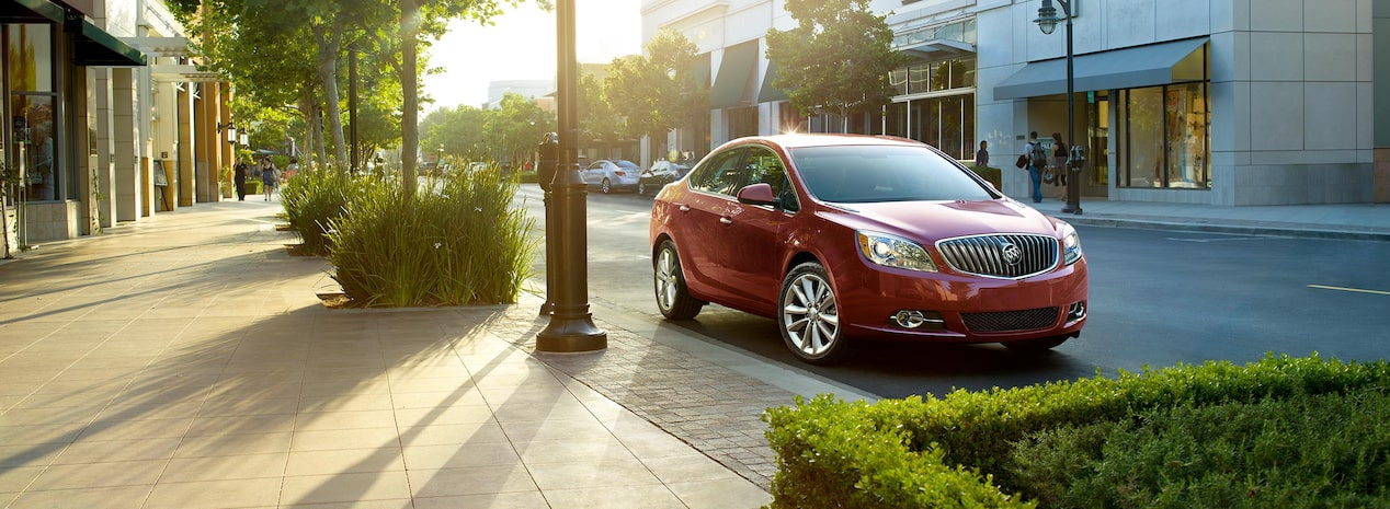 Masthead image of the 2017 Buick Verano small luxury sedan parked on the street.