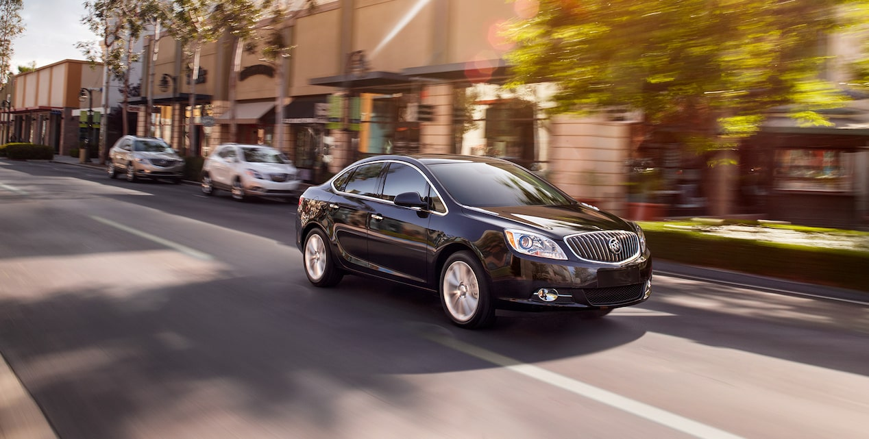 Image showing the 2017 Buick Verano small luxury sedan in motion on the street.