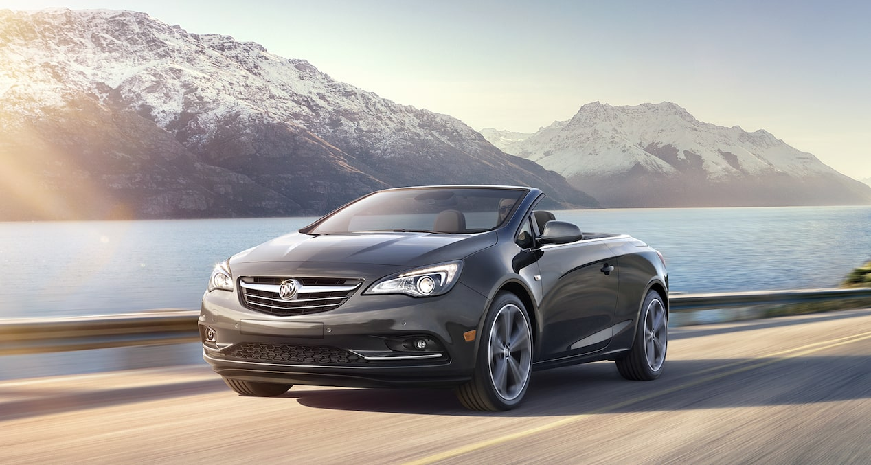 Image of the 2017 Buick Cascada luxury convertible in motion on a mountainous countryside road.