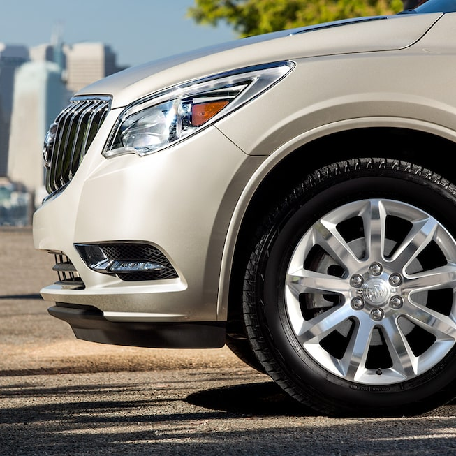 "2017 Enclave mid-size luxury SUV available 20"" bright-machined aluminum wheel with Blade Silver pockets."