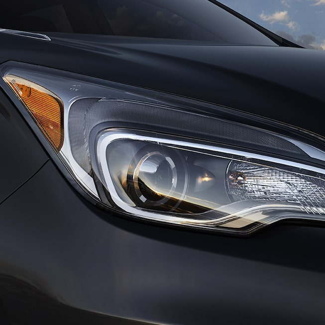2017 Envision small luxury SUV front exterior headlamp.
