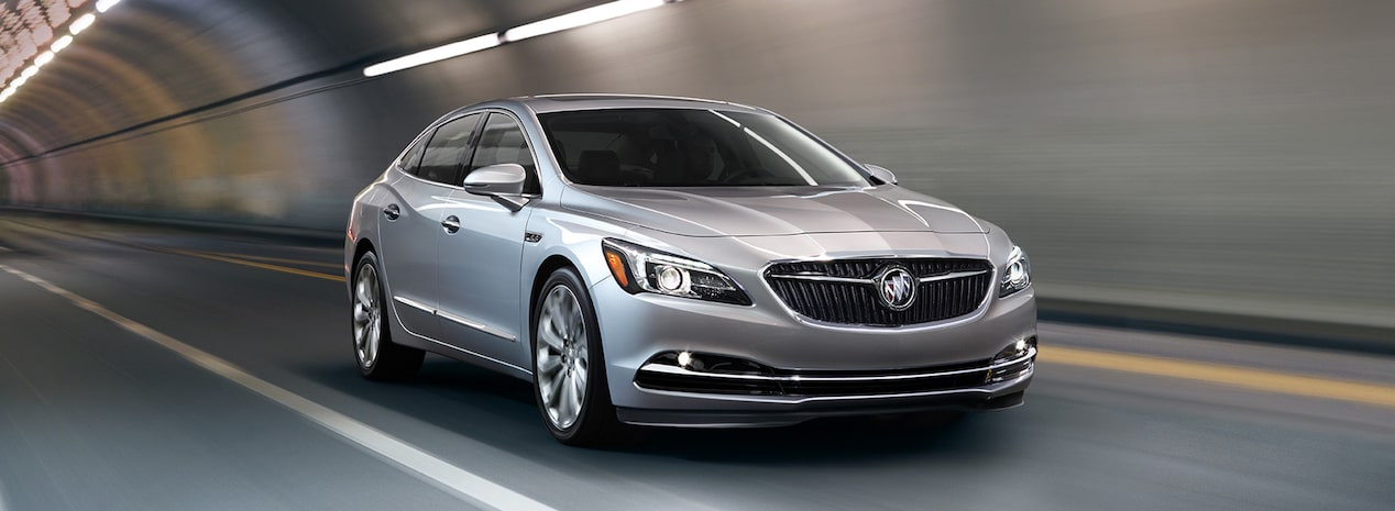 Masthead image for the page featuring the 2018 Buick LaCrosse full-size luxury sedan in motion in a lit tunnel.