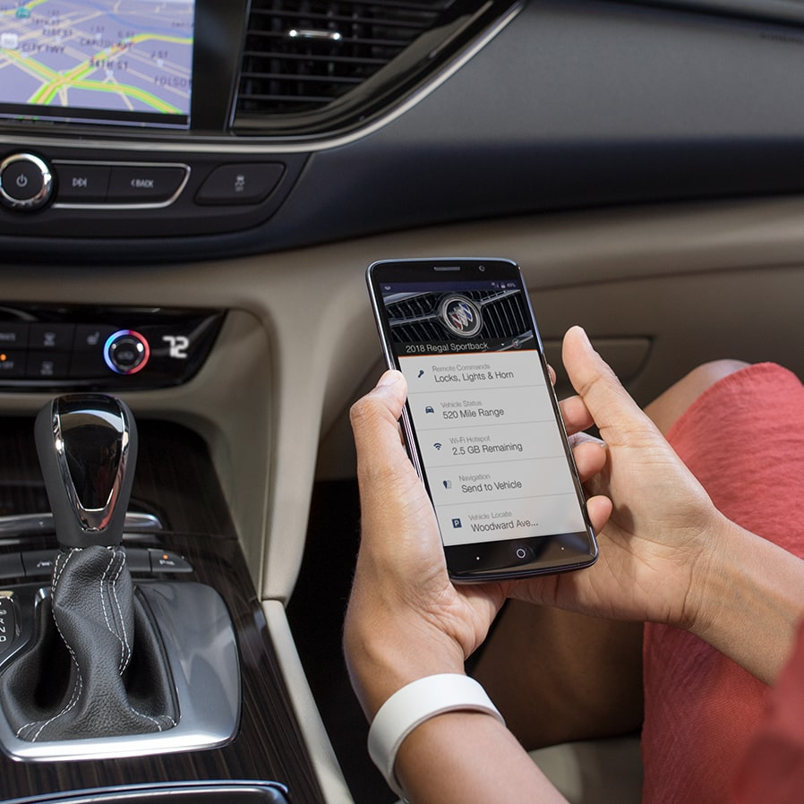 Image showing myBuick App on smartphone in the Regal Sportback mid-size luxury sedan