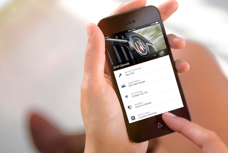 Image of someone using a smartphone to access the myBuick app to control key features of the 2018 Buick Cascada luxury convertible.