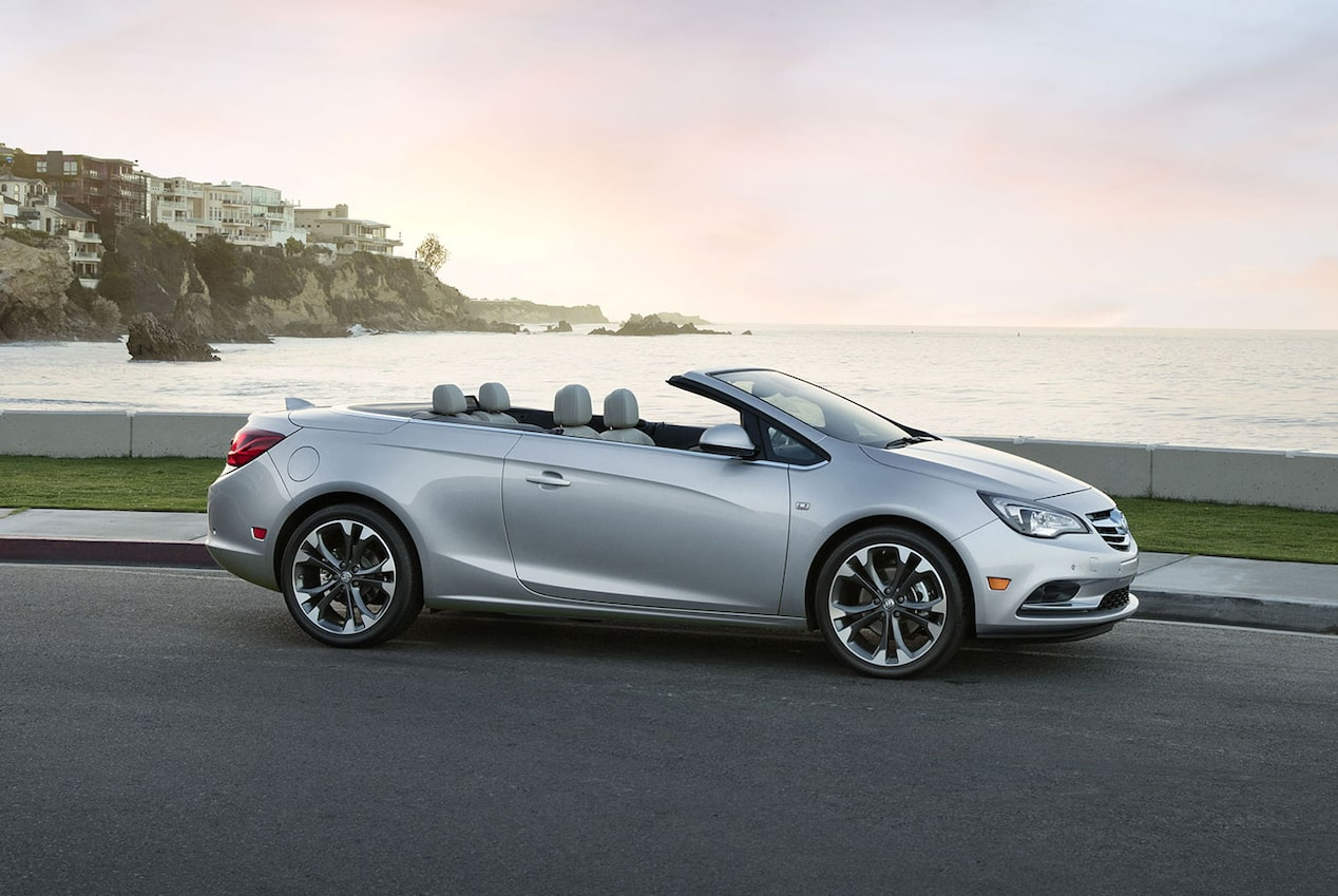 Image of the 2018 Buick Cascada luxury convertible in motion on a waterside road.