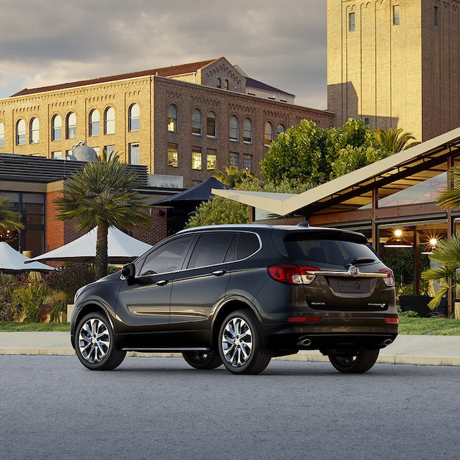 2018 Envision small luxury SUV exterior photo shown in ebony twilight metallic.