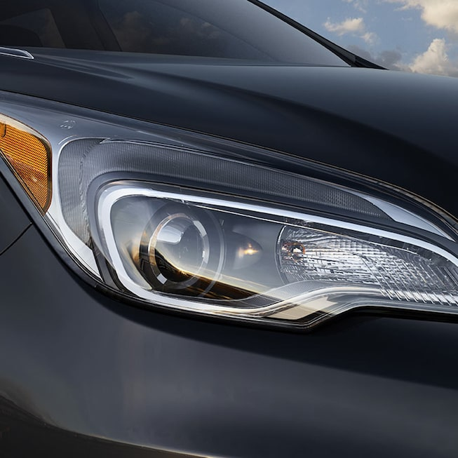 2018 Envision small luxury SUV exterior photo of headlamp.