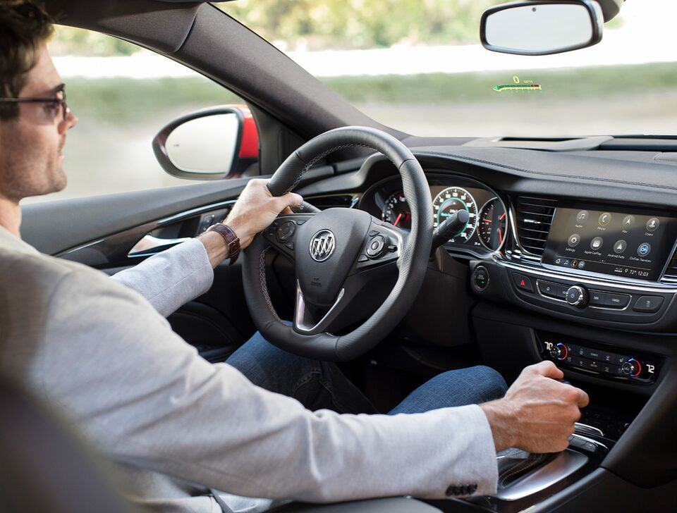 2020 Buick Regal GS Mid-Size Luxury Sedan: a man driving with hand on shift gear