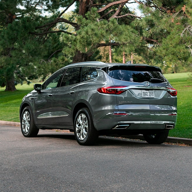 2020 Buick Enclave mid-size luxury SUV MOV Gallery rear exterior with tree