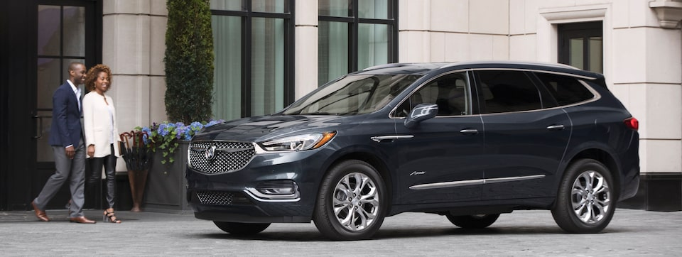 2020 Buick Enclave Avenir mid-size luxury SUV side with couple image