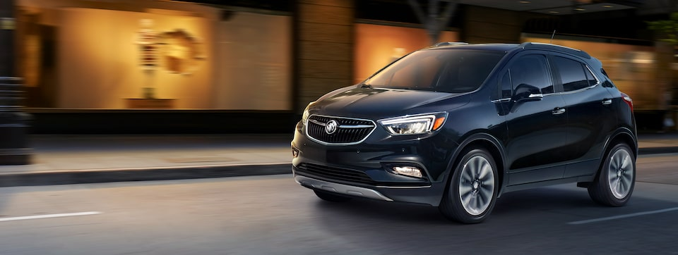 2020 Buick Encore Small Luxury SUV: exterior view with headlights on