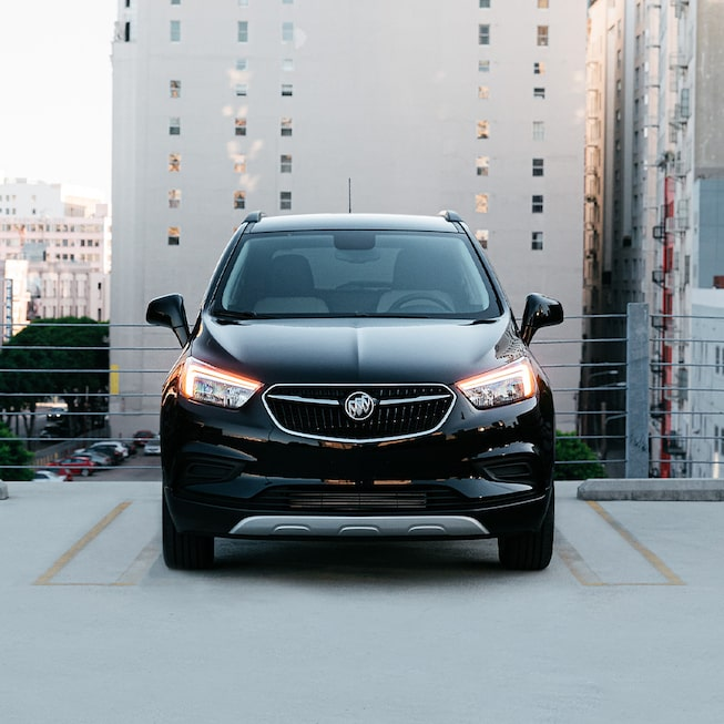 2020 Buick Encore Small Luxury SUV: two men bike racking