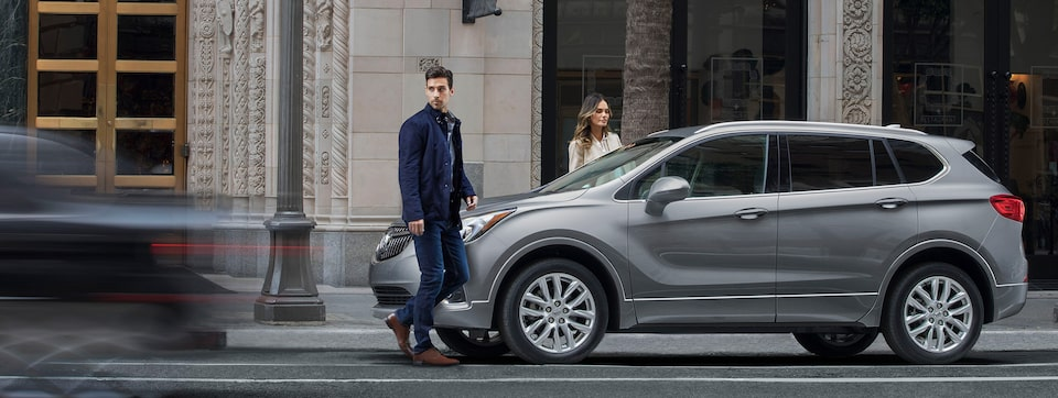 2020 Buick Envision Compact SUV Side Profile With Man Walking In Front