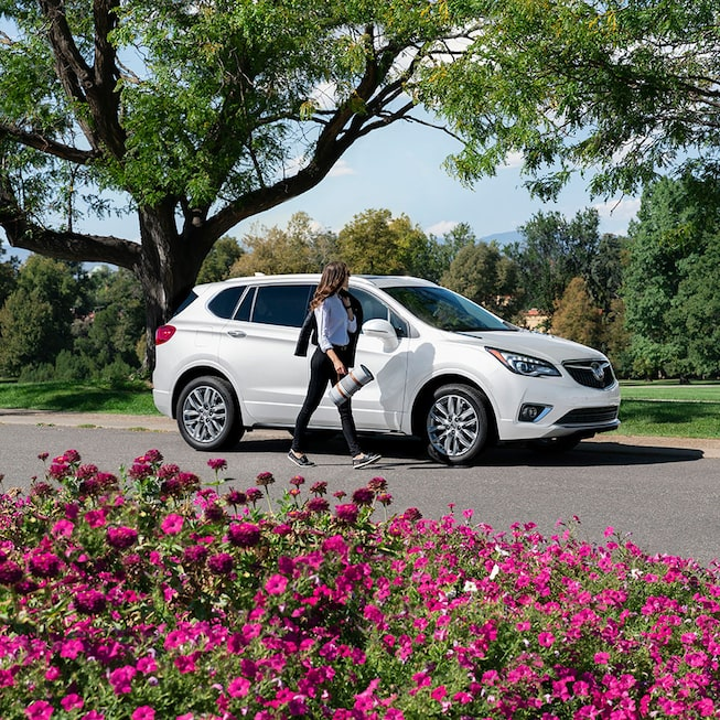 2020 Buick Envision Compact SUV Side Exterior With Woman Walking