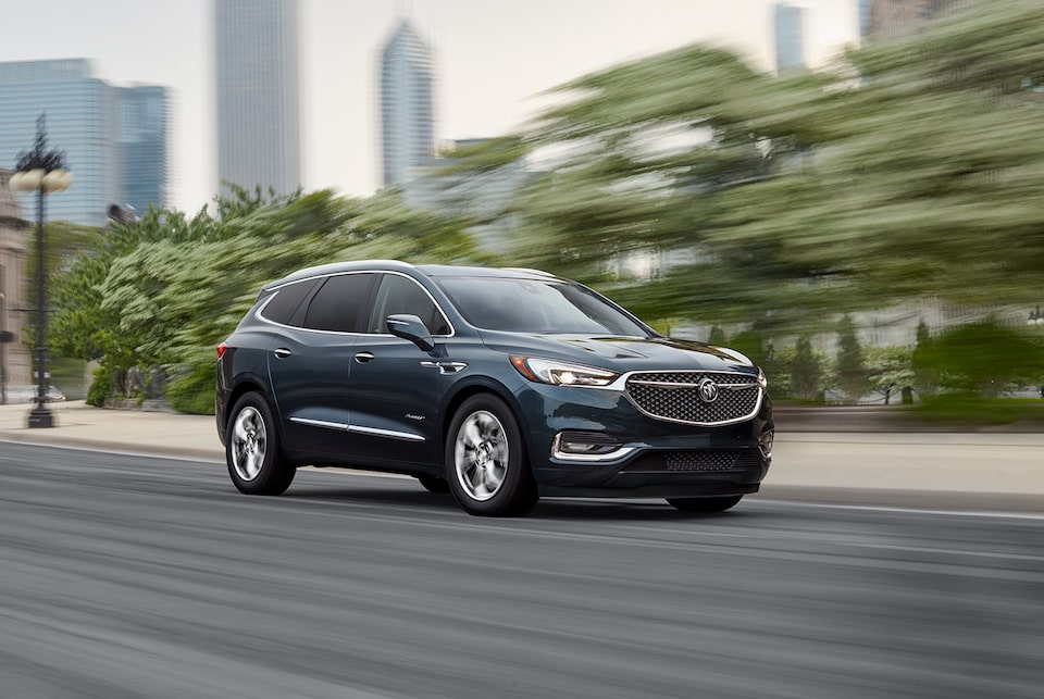 2020 Buick Enclave Avenir Luxury Mid-Size SUV driving on road