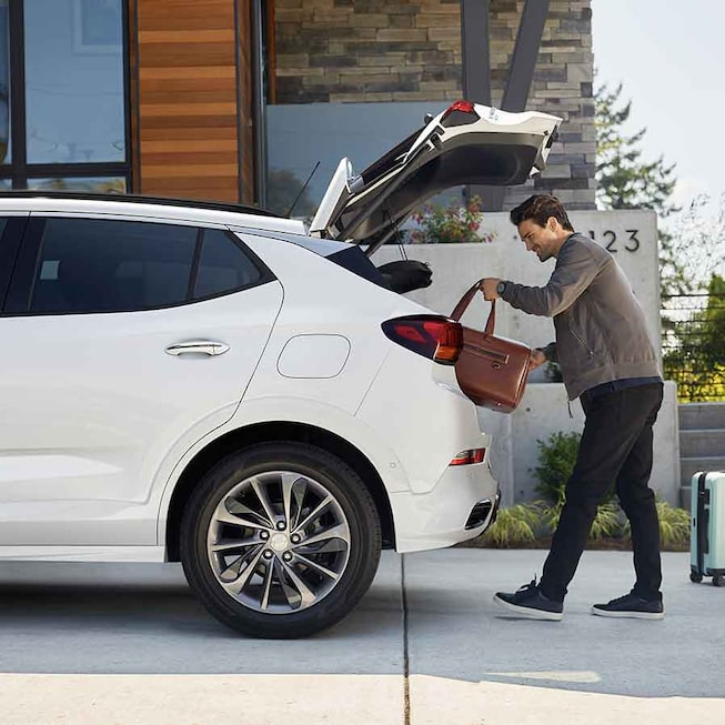 2021 Buick Encore GX ST Sporty SUV putting luggage into trunk